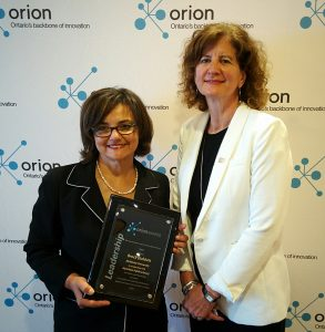 Kathryn Anthonisen, Vice-President, External Relations, CANARIE, presents Brock Dubbels with the 2016 ORION Innovation Leadership Award. Brock was not present, and the award was accepted on his behalf by Sherry Fahim, Director Digital Technology and Creation, Hamilton Public Library